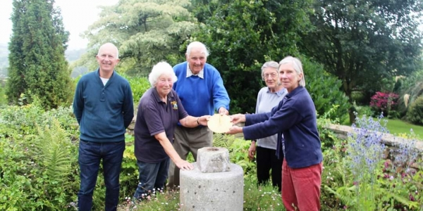 Burrow Farm Gardens being awarded a sundial to celebrate being an NGS garden for 40 years